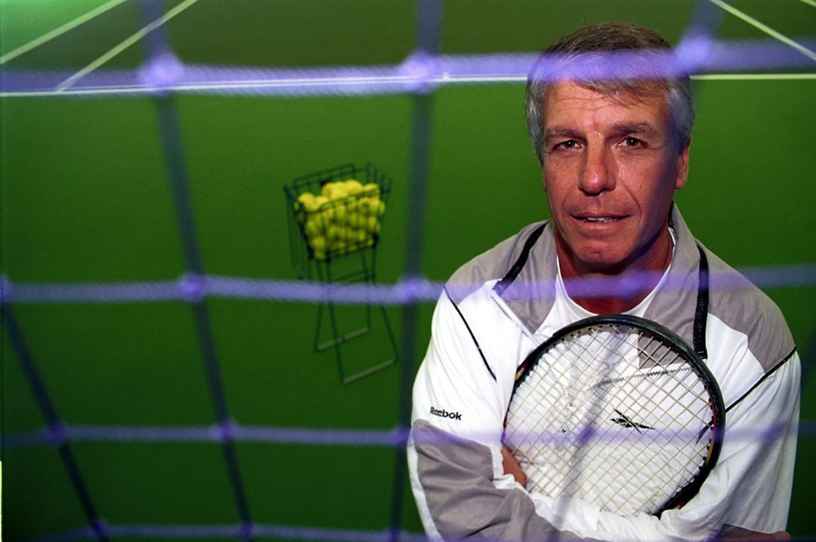 A tennis coach ready to deliver a session